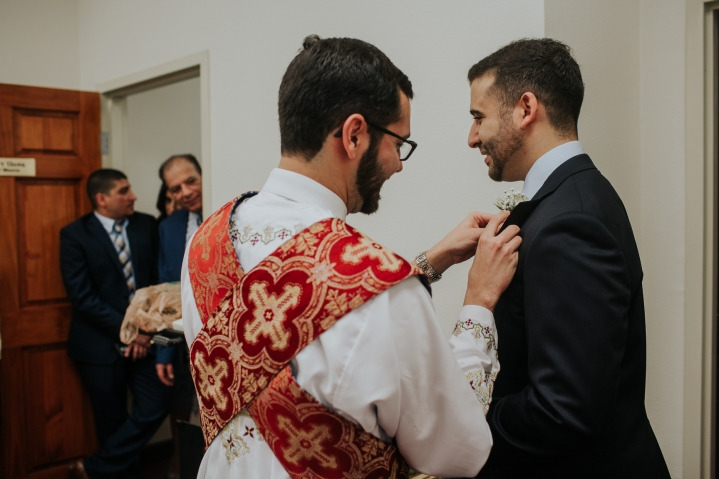 pinning the boutonnière for coptic engagement