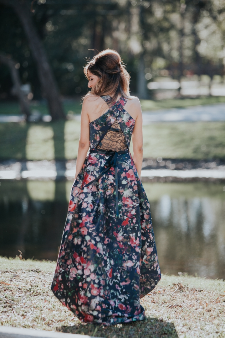 bride to be in flowered gown by lake