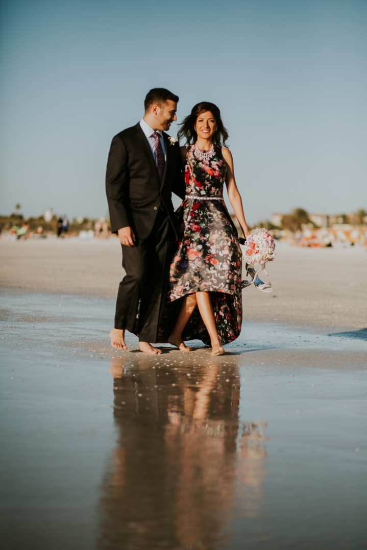 engaged couple on clearwater beach portrait