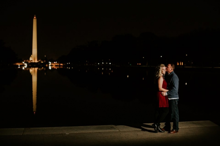 night portraits with the newly engaged couple and the washington monument
