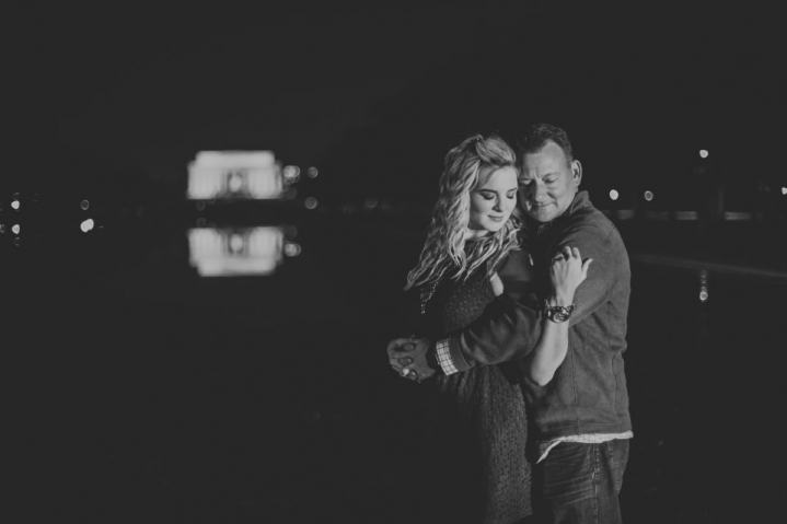 night portraits with the newly engaged couple and the lincoln monument