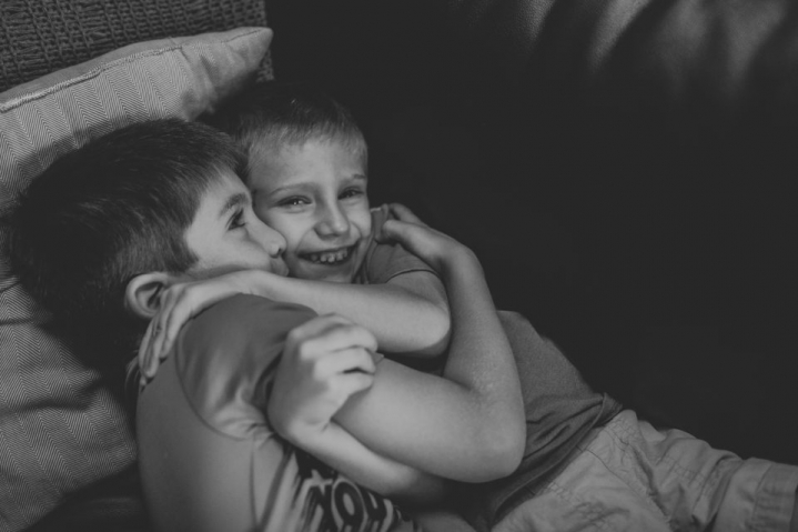 cuddling brothers during in-home session